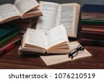a stack of books on the table....   Shutterstock . vector #1076210519