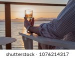 man sitting on deck chair at... | Shutterstock . vector #1076214317