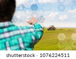 farmer manages planting on the... | Shutterstock . vector #1076224511
