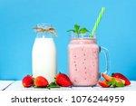 jar of milkshake with... | Shutterstock . vector #1076244959