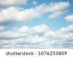fluffy clouds.closeup blue sky... | Shutterstock . vector #1076253809