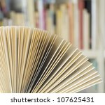 open book in a library - stock photo