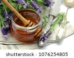 lavender honey in a glass with... | Shutterstock . vector #1076254805