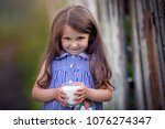 cute little beautiful girl with ...   Shutterstock . vector #1076274347
