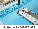 cropped portrait of repairman...   Shutterstock . vector #1076276675