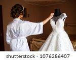 bride in a white wedding dress... | Shutterstock . vector #1076286407