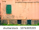 small window with closed green... | Shutterstock . vector #1076305205
