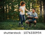young couple standing next to a ... | Shutterstock . vector #1076330954