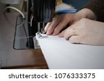 hands of woman working on the... | Shutterstock . vector #1076333375