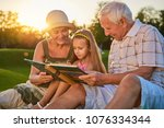 girl with grandparents  photo... | Shutterstock . vector #1076334344