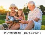 people looking through photo... | Shutterstock . vector #1076334347