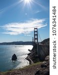 Small photo of San Francisco golden gate bridge on a high noon sun on a clear bright day, vertical orientation