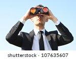business man with binoculars on ...   Shutterstock . vector #107635607