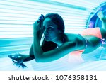 young slender girl in a bathing ... | Shutterstock . vector #1076358131