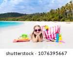 child at tropical beach with... | Shutterstock . vector #1076395667