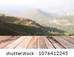 old wood table top on mountain... | Shutterstock . vector #1076412245