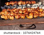 closeup of tasty roasted meat... | Shutterstock . vector #1076424764