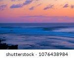 sunset waves uluwatu | Shutterstock . vector #1076438984