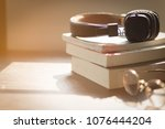vintage headphone on books with ... | Shutterstock . vector #1076444204