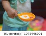 cute little girl having fun...   Shutterstock . vector #1076446001