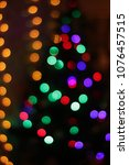 Small photo of bokeh lights and radiance geranda from a Christmas tree