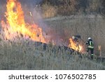 Firefighters Battle A Wildfire...