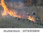 Firefighters Battle A Wildfire...