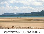 long sandy beach at chumphon ... | Shutterstock . vector #1076510879