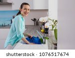 portrait of a smiling woman in... | Shutterstock . vector #1076517674