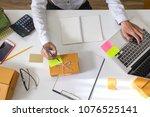 young entrepreneur man using... | Shutterstock . vector #1076525141