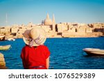 tourist looking at malta... | Shutterstock . vector #1076529389