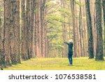 young asian woman enjoying in... | Shutterstock . vector #1076538581
