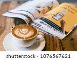 cup of coffee   latte art on... | Shutterstock . vector #1076567621