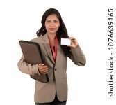 Small photo of Smiling business woman holding a blank business card or ID card over white background