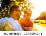 a beautiful young couple... | Shutterstock . vector #1076654141