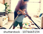 son helping his mather clean...   Shutterstock . vector #1076665154
