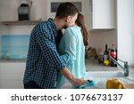 man kisses a woman in the neck... | Shutterstock . vector #1076673137