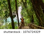 hiking in green tropical jungle ... | Shutterstock . vector #1076724329