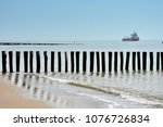 wooden wave breakers in... | Shutterstock . vector #1076726834