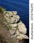 gray granite stone shore of the ... | Shutterstock . vector #1076746295