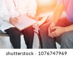 male patients with psychologist ... | Shutterstock . vector #1076747969