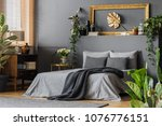 gold leaf in frame on the wall... | Shutterstock . vector #1076776151