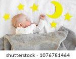 little sleepy child in the bed. ... | Shutterstock . vector #1076781464
