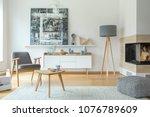 grey armchair next to a wooden... | Shutterstock . vector #1076789609