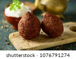 kibbeh  a levantine dish  on a...   Shutterstock . vector #1076791274