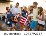 friends celebrating 4th of july ... | Shutterstock . vector #1076792387
