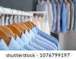 rack with clean clothes on... | Shutterstock . vector #1076799197