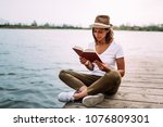 gorgeous woman sitting on... | Shutterstock . vector #1076809301