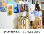 rear view of left handed female ... | Shutterstock . vector #1076816597