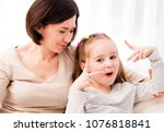 mother and little daughter... | Shutterstock . vector #1076818841